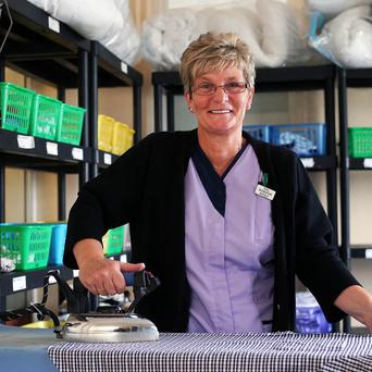 Laundry manager Val Robson is hanging up her iron after 30 years on the board