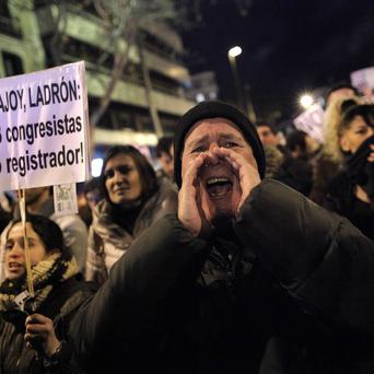 Protesters outside Spain's Popular Party headquarters (AP)