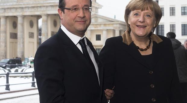 Merkel and Hollande are working together on an economic plan (AP)