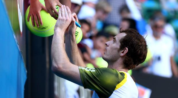 MELBOURNE, AUSTRALIA - JANUARY 23: Andy Murray of Great Britain signs an autograph after winning his Quarterfinal match against Jeremy Chardy of France during day ten of the 2013 Australian Open at Melbourne Park on January 23, 2013 in Melbourne, Australia. (Photo by Cameron Spencer/Getty Images)