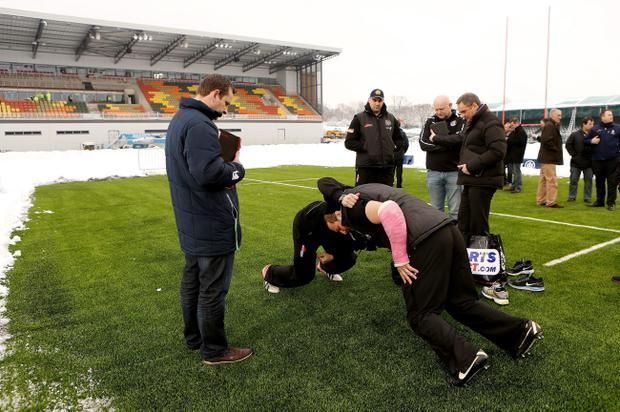 Saracens' players try out the surface on the new pitch on which Ulster may have to play
