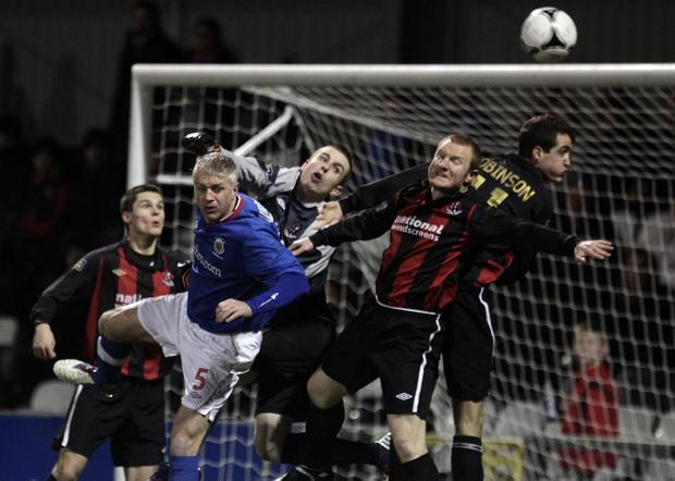 Crusaders' Craig Hyland and David Magowan battle with Linfield's William Murphy
