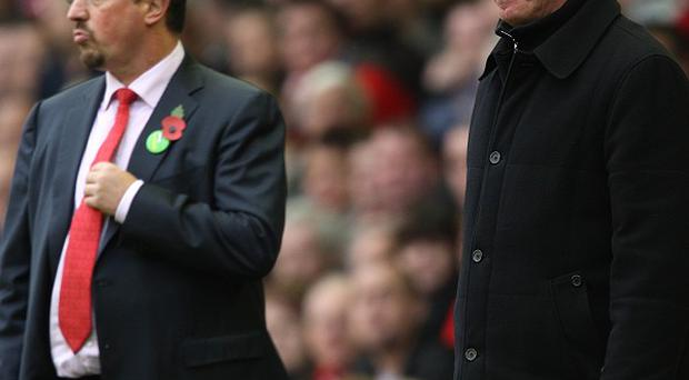 Rafael Benitez, left, has not seen eye-to-eye with Sir Alex Ferguson in recent years