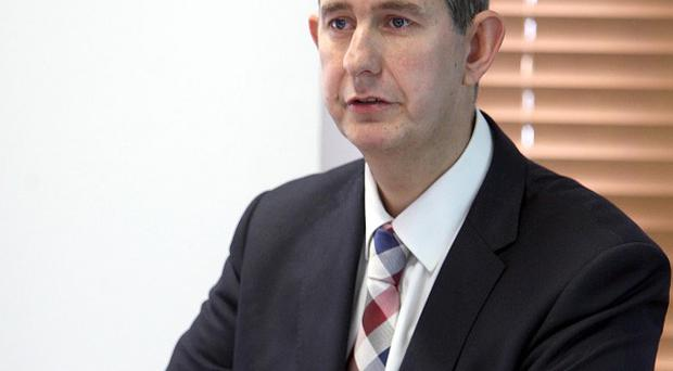 Health Minister Edwin Poots said care needed to be moved out of the hospital and into the community where appropriate
