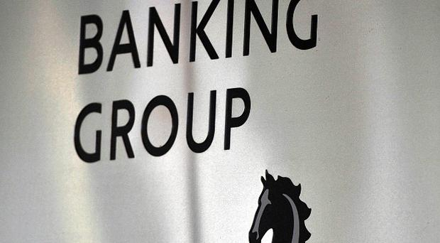 Lloyds Banking Group has announced plans to cut more than 900 jobs