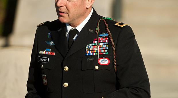 Army Brigadier General Jeffrey Sinclair is to face trial over charges including wrongful sexual conduct (AP)