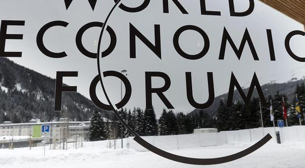 Syria's bombardment of its citizens should be declared a war crime, the World Economic Forum in Davos has heard (AP)