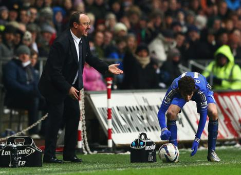 SWANSEA, WALES - JANUARY 23: Rafael Benitez interim manager of Chelsea reacts during the Capital One Cup Semi-Final Second Leg match between Swansea City and Chelsea at Liberty Stadium on January 23, 2013 in Swansea, Wales. (Photo by Michael Steele/Getty Images)