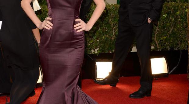 Taylor Swift works burgundy on red carpet
