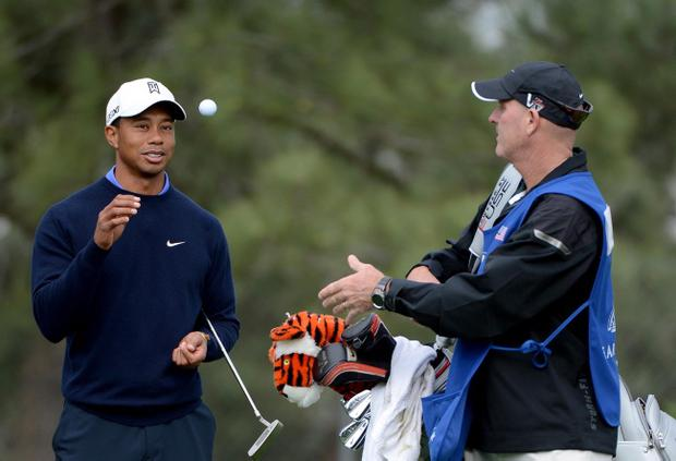 LA JOLLA, CA - JANUARY 23: Tiger Woods catches the ball from caddie Joe LaCava during the Pro-Am at the Farmers Insurance Open at Torrey Pines North Golf Course on January 23, 2013 in La Jolla, California. (Photo by Donald Miralle/Getty Images)