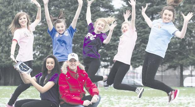 DJ and music producer Micky Modelle with Gemma Bradley and fellow pupils from St Patrick's College (from left) Hannah Ferguson, Marie Terese Mullan, Deborah Mulholland, Adele McGrogan and Orlaith Convery