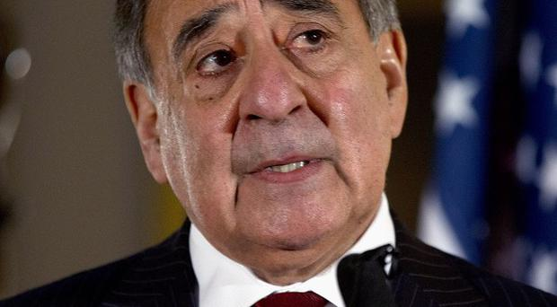 Defence Secretary Leon Panetta has removed the US military ban on women in combat (AP)