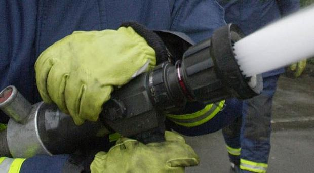 Health minister Edwin Poots called for urgent and fundamental change at the fire service