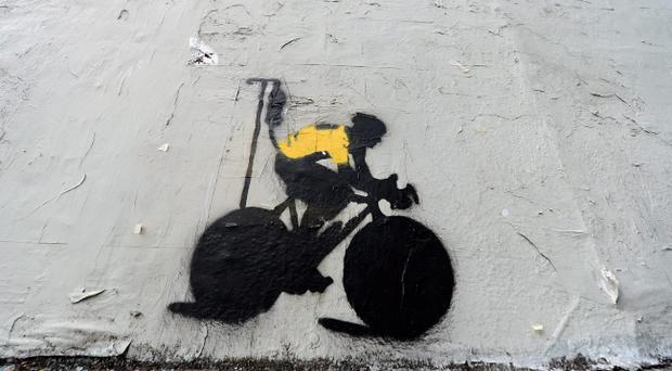 LOS ANGELES, CA - JANUARY 23: A stencil graffiti depicting cyclist Lance Armstrong in a yellow jersey, the traditional garb of the seven-time Tour De France winner, attached to an IV drip is pictured on the side of a building on January 23, 2013 in Los Angeles, California. Armstrong recently admitted to using performance enhancing drugs after being found guilty by the United States Anti-Doping Agency and stripped of his titles. (Photo by Kevork Djansezian/Getty Images)