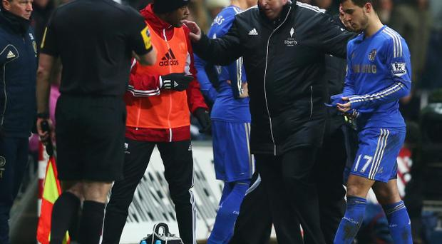 Eden Hazard of Chelsea (R) is sent off after kicking a ball boy during the Capital One Cup Semi-Final Second Leg match between Swansea City and Chelsea at Liberty Stadium on January 23, 2013 in Swansea