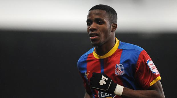 Crystal Palace are deeply divided over whether to sell Wilfried Zaha this month
