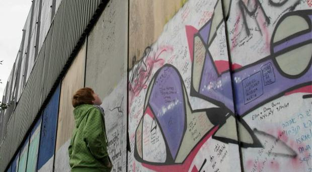 One of the estimated 21 miles of peace walls in Belfast