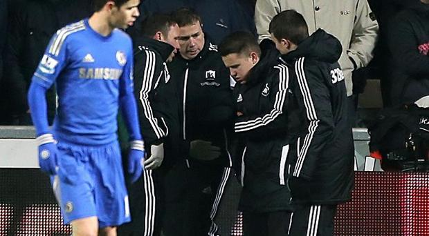 Charlie Morgan, second right, was kicked by Chelsea star Eden Hazard after laying on a ball