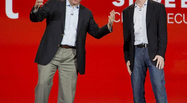 Microsoft CEO Steve Ballmer, left, and Qualcomm CEO Paul Jacobs at the Consumer Electronics Show in Las Vegas (AP)