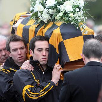 The coffin of James Hughes was carried through Crossmaglen, Co Armagh, by his team mates during his funeral in December 2011