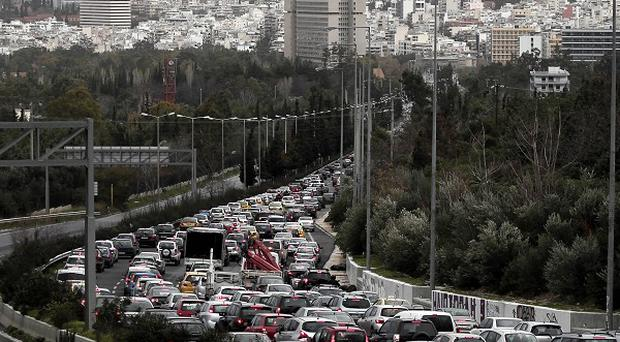 Cars were caught in a traffic jam during a strike by metro employees in Athens, Greece (AP)