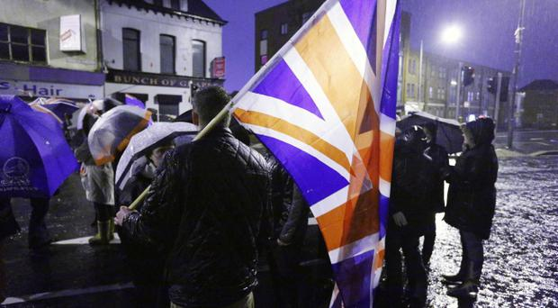 Loyalists take part in a peaceful protest at Beersbridge Road last night as part of the ongoing flags dispute