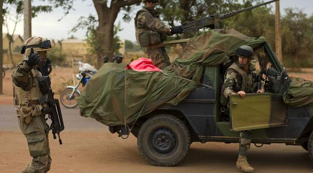 French soldiers stand at a crossroads as they arrive in the city of Sevare, Mali (AP)