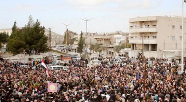Syrians take part in a funeral procession for those killed in a car bomb explosion in Salamiya, in Hama province (AP/Sana)