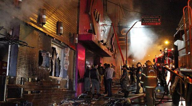 Firefighters work to douse a blaze at the Kiss Club in Santa Maria city, Brazil (AP)