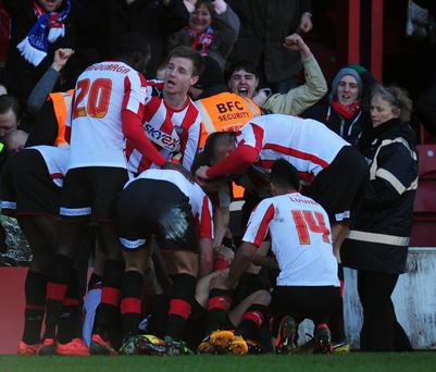 LONDON, ENGLAND - JANUARY 27: Marcello Trotta of Brentford is surrounded by team mates after scoring during the FA Cup with Budweiser Fourth Round match between Brentford and Chelsea at Griffin Park on January 27, 2013 in Brentford, England. (Photo by Jamie McDonald/Getty Images)