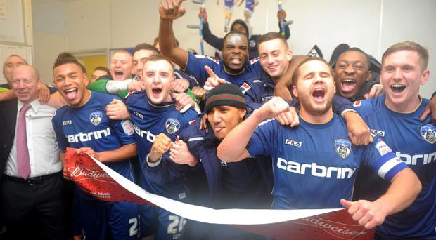 Oldham Athletic players celebrate in the dressing room during the FA Cup, Fourth Round match at Boundary Park, Oldham