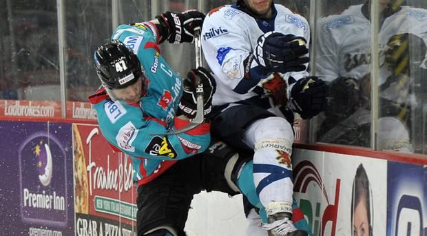 Adam Keefe of the Belfast Giants puts a big check on Michal Benadik of the Edinburgh Capitals in the Elite League game in Belfast
