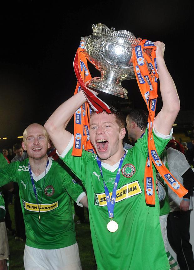 Stephen Garrett leads the celebrations as Cliftonville lift the IRN BRU League Cup
