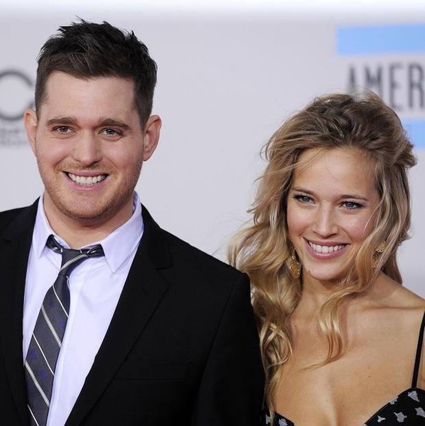 Michael Buble, left, and Luisana Lopilato