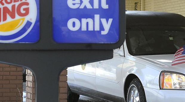 A hearse carrying David Kime Jr pulls up to the drive-through at Burger King in York, Pennsylvania (AP)