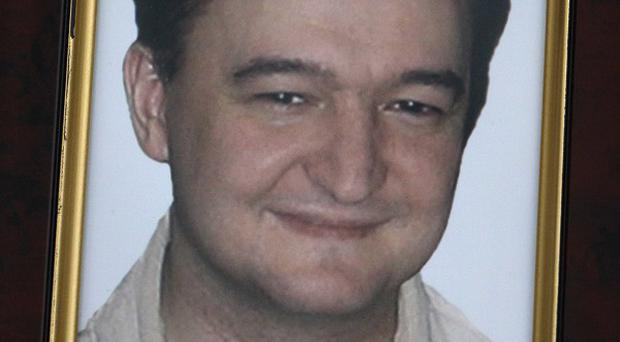 Russian lawyer Sergei Magnitsky is facing trial - even though he is dead (AP)