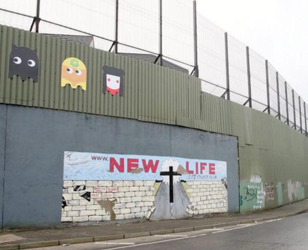 Peace walls like this one will have to come down if the Northern Ireland economy is to prosper