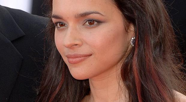 Norah Jones said she is delighted to be singing at the Oscars
