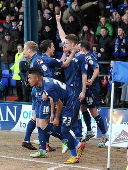Oldham players celebrate Matt Smith (centre) scoring against Liverpool on Sunday afternoon