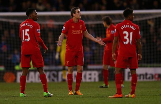 Jordan Henderson (centre) couldn't find the answers to Liverpool's problems as they exited the FA Cup at Oldham