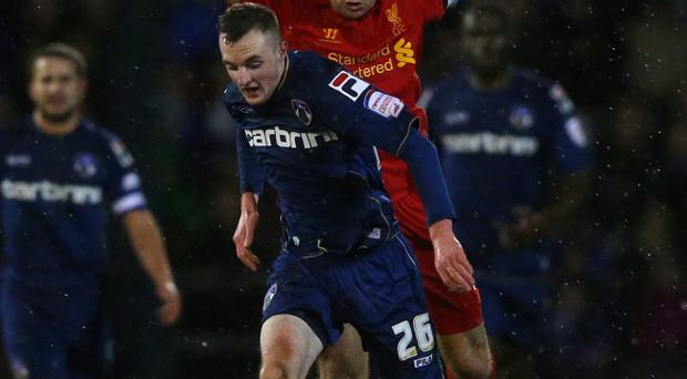 Carl Winchester beats Liverpool captain Steven Gerrard during Oldham Athletic's FA Cup victory over the Merseysiders