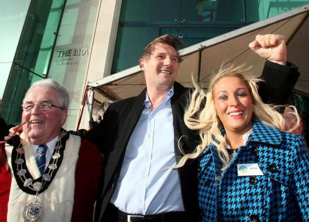 Liam Neeson is welcomed by Ballymena mayor PJ McAvoy and Carla Speer