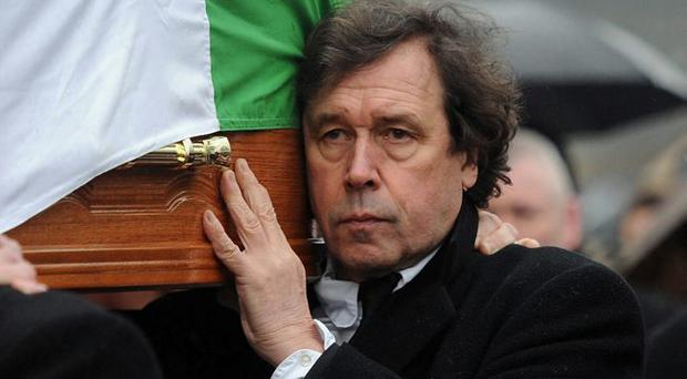 Actor Stephen Rea, former husband of Dolours Price helps carry her coffin on Monday