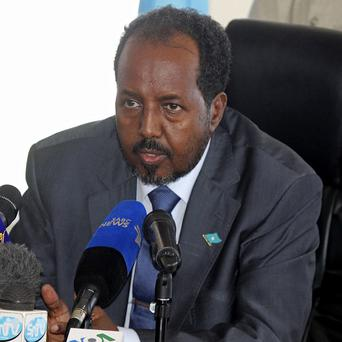 Somalia's president Hassan Sheikh Mohamud was reportedly out of the country when a suicide bomber targeted his compound (AP)