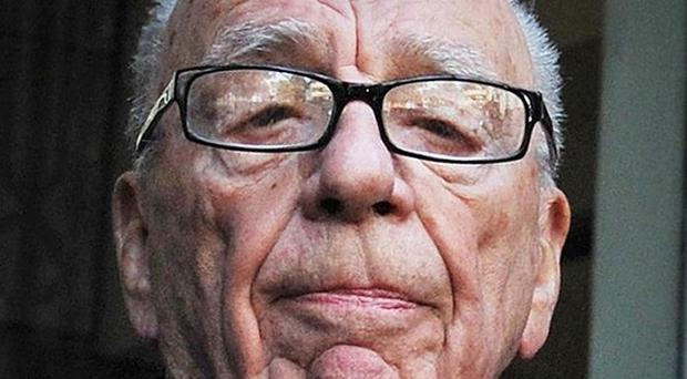Rupert Murdoch used Twitter to apologise for a 'grotesque' cartoon in the Sunday Times
