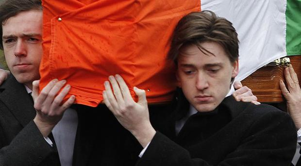 Dolours Price's coffin is carried from her family home in Slievegallion Drive in Andersontown
