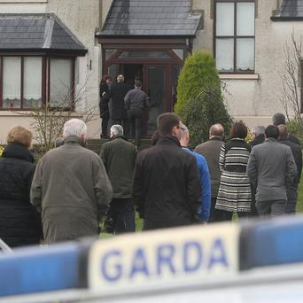 Mourners at the home of murdered Detective Garda Adrian Donohoe in Dundalk