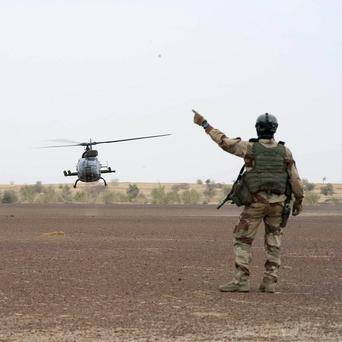 A French soldier directs helicopters near Timbuktu, north Mali (AP/ECPAD)