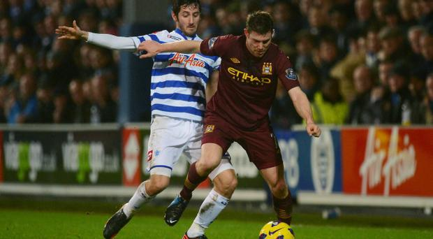 LONDON, ENGLAND - JANUARY 29: James Milner of Manchester City holds off the challenge from Esteban Granero of QPR during the Barclays Premier League match between Queens Park Rangers and Manchester City at Loftus Road on January 29, 2013 in London, England. (Photo by Mike Hewitt/Getty Images)