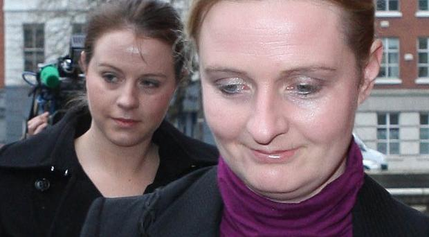 Sean Quinn's daughters Aoife, left, and Ciara, right, arrive at the Commercial Court in Dublin